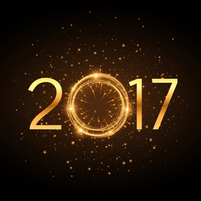 golden 2017 new year text with glowing glitter effect and fireworks